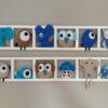 cadre mural decoratif chambre garçon figurines tons beige taupe bleu